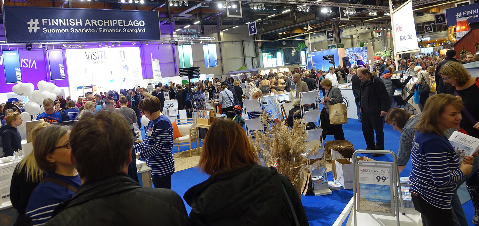 Fair visitors and exhibitors at the Matka Nordic Travel Fair's Finnish Archipelago stand in 2017. The Finnish Archipelago stand is a large, joint stand of over ten cities and communities located in the Southwestern Finland.